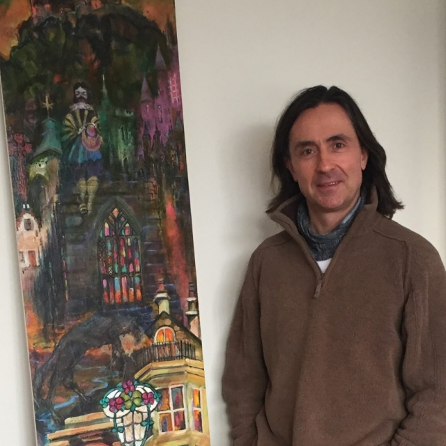 Dr Neil Oliver with his commissioned painting of the historic town of Stirling